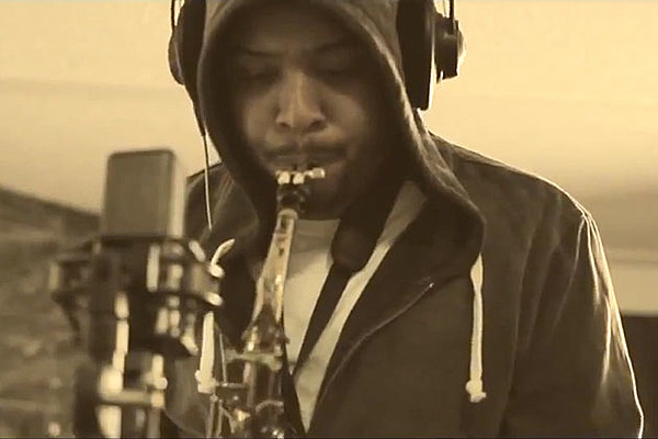 Terrace martin soothes on the saxophone in 39 angel 39 video for Terrace martin