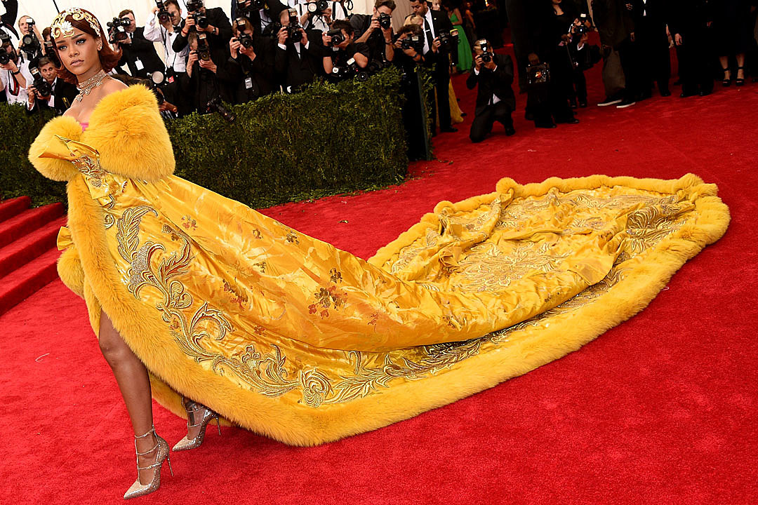 Image result for Rihanna has had practice in stopping the Met Gala in its tracks - remember the yellow satin ensemble with a long fur-lined train by Chinese designer Guo Pei? On Monday, the Internet resurrected Rihanna's 2015 Met Gala look: